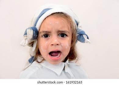 portrait of a beautiful caucasian painter girl screaming