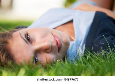 Portrait of beautiful caucasian teenager girl in park outdoors