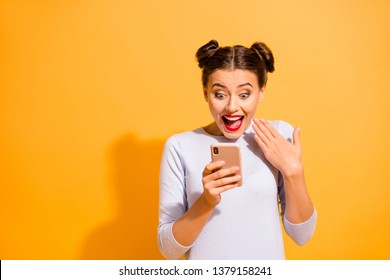 Portrait of beautiful charming girl impressed by incredible information from social networks about sales discounts waving her hand wearing white cotton pullover over vivid background