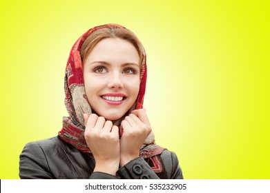 Portrait of beautiful charming smiling woman isolated on yellow background.