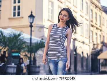 Portrait of beautiful charming smiling woman in the city
