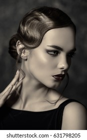 Portrait of a beautiful charming woman with old fashioned make-up and finger wave hairstyle.  Luxurious life. Retro style of 20's and 30's. Beauty, fashion concept.