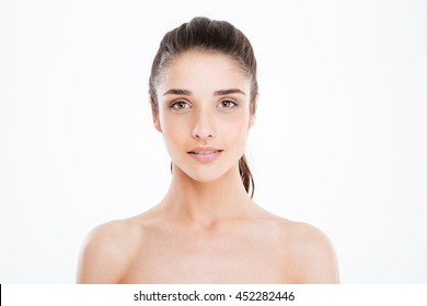 Portrait of beautiful charming young woman with perfect skin over white background