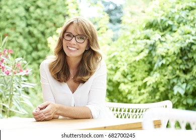 Portrait of a beautiful cheerful woman relaxing outdoor.