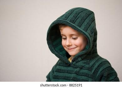 Portrait of a beautiful child wearing a green sweater