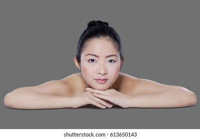 Portrait of beautiful chinese model with healthy skin relaxing in the studio after spa treatment