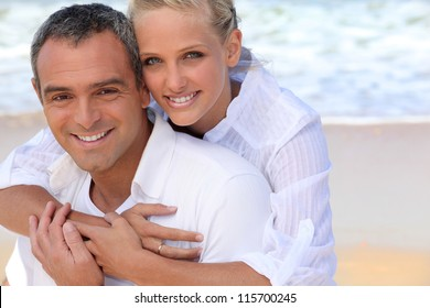 Portrait of a beautiful couple at the beach
