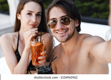 Portrait of a beautiful couple enjoying a cocktail while talking