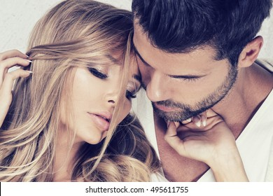 Portrait of beautiful couple. Handsome man posing with blonde woman. Love.