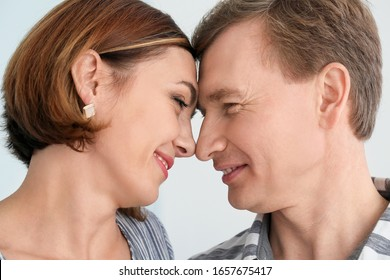 Portrait of beautiful couple on light background