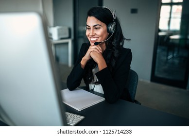Portrait of beautiful customer support with the headset.