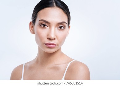 Portrait of beautiful dark-haired woman in tank top