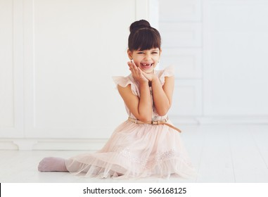 portrait of beautiful delighted little lady with cute toothless smile