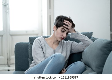 Portrait of Beautiful desperate and depressed young woman on sofa feeling sad, hopeless and in pain suffering from Depression in People, Mental health,broken heart, Grief and Psychology concept.