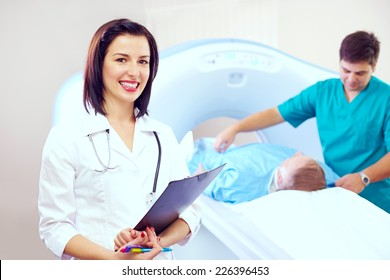 portrait of beautiful doctor in CT scanner room