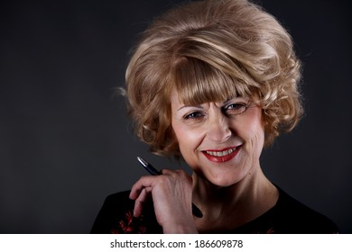 Portrait of beautiful elderly lady on a dark background studio