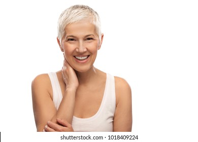 Portrait of a beautiful elderly woman, smiling, isolated on white background