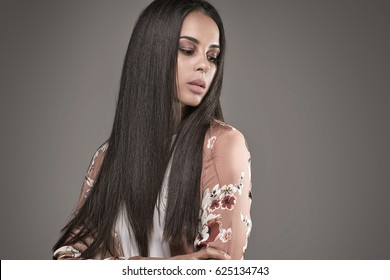 Portrait of beautiful elegant african american woman with long hair and natural glamour makeup. Studio shot.