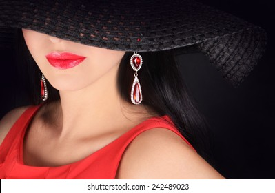 ea1b7f35a2c Portrait of beautiful elegant sexy young woman wearing hat with large brim  over dark background