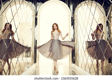 A portrait of a beautiful elegant woman in the evening dress. Fashion, evening dresses for events.
