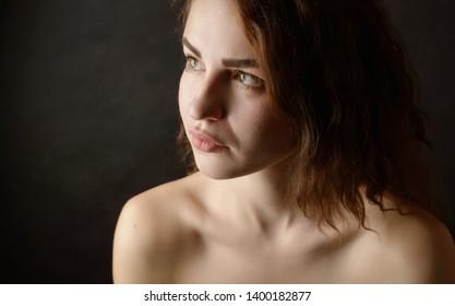 Portrait of beautiful emotional woman with green eyes. Studio shot.