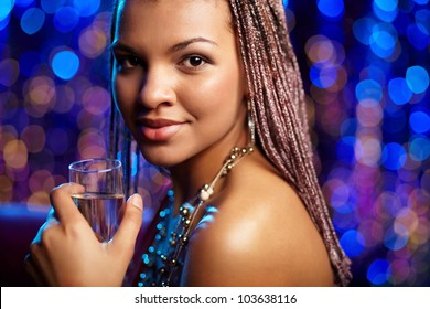 Portrait of a beautiful ethnic woman against twinkling blue background