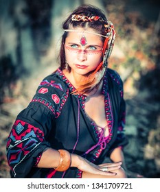 Portrait of a beautiful ethnic woman posing outdoor. Creative makeup