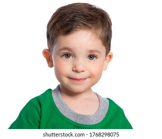 Portrait of a beautiful European boy 2 years old. A beautiful and happy child. A child's smile. Isolated on a white background in a green t-shirt.