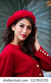 Portrait of beautiful European model wearing red beret and match