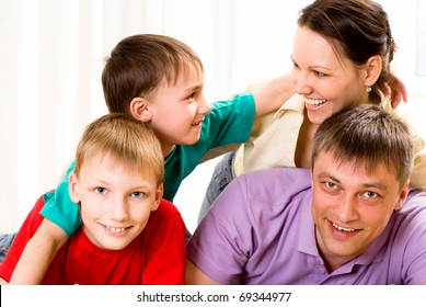 portrait of a beautiful family in the room