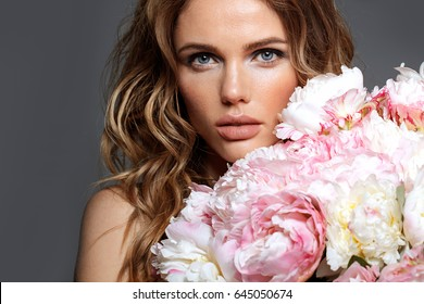 Portrait of a beautiful fashion bride, sweet and sensual. Wedding make up and hair. Flowers. Art modern style. Blue eyes