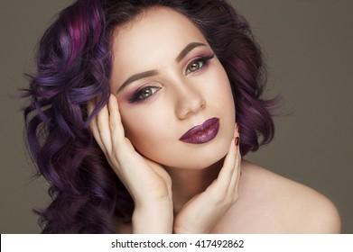 Portrait of beautiful fashion model with purple hair