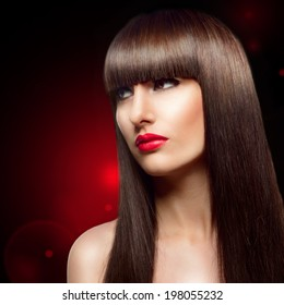 Portrait of beautiful fashion woman with long healthy brown hair and fringe hairstyle.