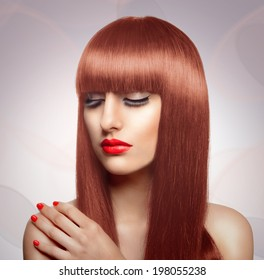 Portrait of beautiful fashion woman with long healthy red hair and fringe hairstyle.