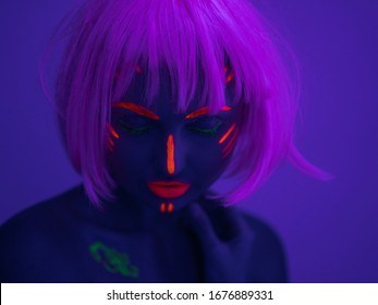 Portrait of Beautiful Fashion Woman in Neon UF Light. Model Girl with Fluorescent Creative Psychedelic MakeUp, Art Design of Female Disco Dancer Model in UV, Colorful Abstract Make-Up