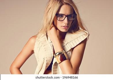Portrait of beautiful fashion woman wearing glasses