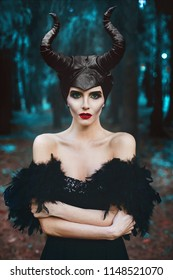 Portrait of beautiful and fashionable brunette slim model girl, with bright makeup and red lips, at mystic forest - fairytale story, cosplay