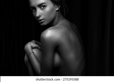 Portrait of beautiful fashionable girl from the back in the studio