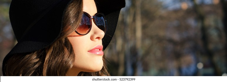 Portrait of the beautiful fashionable girl outdoor on sunny spring day.
