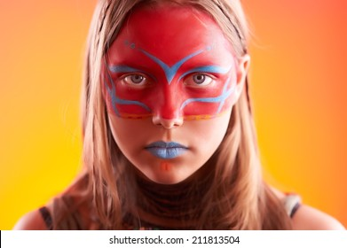 Portrait of a beautiful fashionable teen girl with make-up
