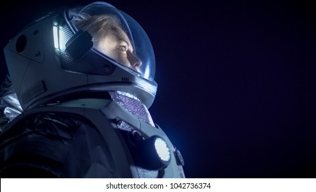 Portrait of the Beautiful Female Astronaut Space Walking, Looking around in Wonder. Space Travel, Extraterrestrial Exploration and Solar System Colonization Concept.