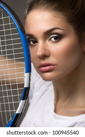 portrait of a beautiful female athletes with a tennis racket from a person in close-up