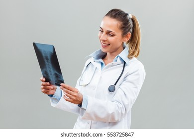 Portrait of beautiful female doctor holding x-ray.Female doctor holding x-ray