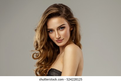 Portrait of beautiful female face with natural skin