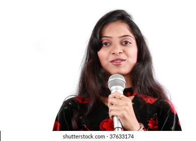 A portrait of a beautiful female host of a talk show in India, on white studio background.
