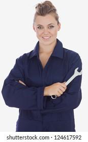 Portrait of beautiful female mechanic holding wrench against white background