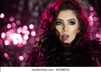 Portrait of a beautiful female model with curly hair with fashion makeup in landscape orientation