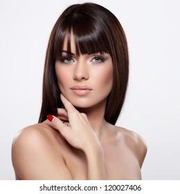 Portrait of beautiful female model on grey background