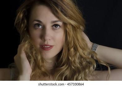 Portrait of beautiful female model on black background