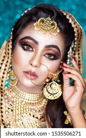 Portrait of a beautiful female model in traditional indian or Arabian  bridal costume with makeup and jewellery